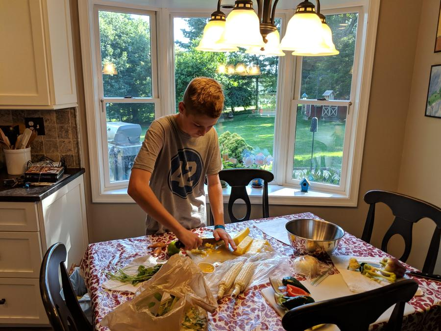 One camper prepping for a delicious meal at home.